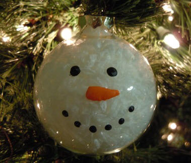 Do it yourself christmas decorations you can draw on it or glue things into the ornament just make sure you dont melt the ornament diy christmas tree cards solutioingenieria
